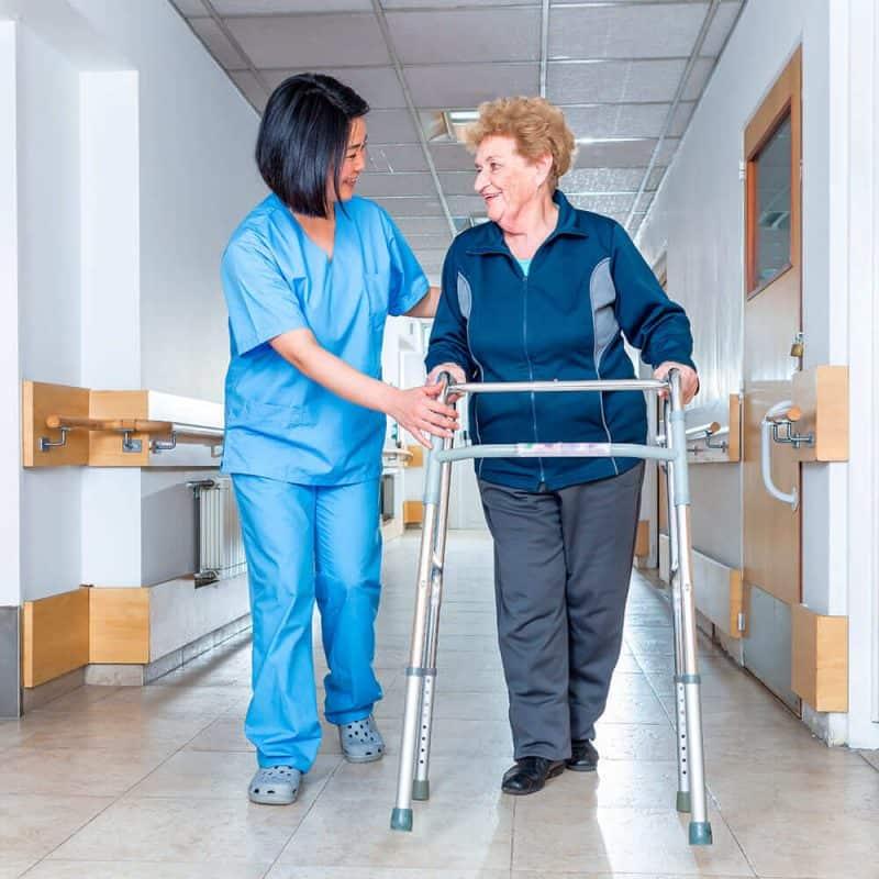 Nurse assisting older women in the hospital